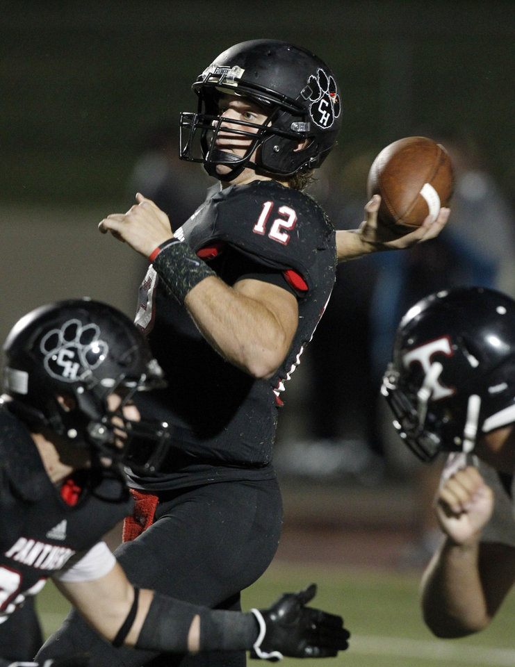 Photo - Colleyville quarterback Cody Thomas (12) throws against Euless Trinity during their high school football game on Friday, September 28, 2012.  (Michael Ainsworth//The Dallas Morning News)