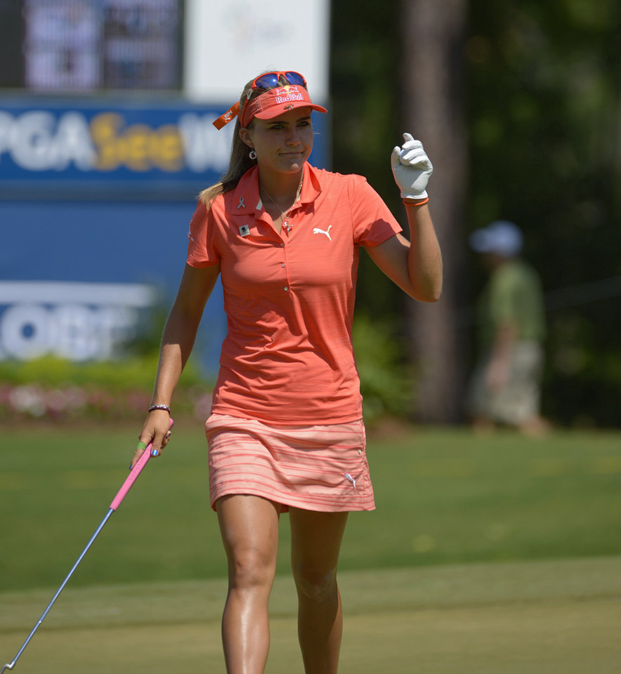 Photo - Lexi Thompson acknowledges the crowd after putting on the 18th hole during the second round of the Airbus LPGA Classic golf tournament at Magnolia Grove on Friday, May 23, 2014, in Mobile, Ala. (AP Photo/G.M. Andrews)