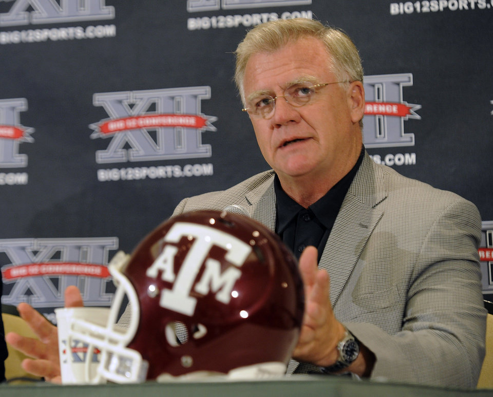 Photo - Texas A&M coach Mike Sherman speaks to reporters during Big 12 Media Days on Monday. AP PHOTO