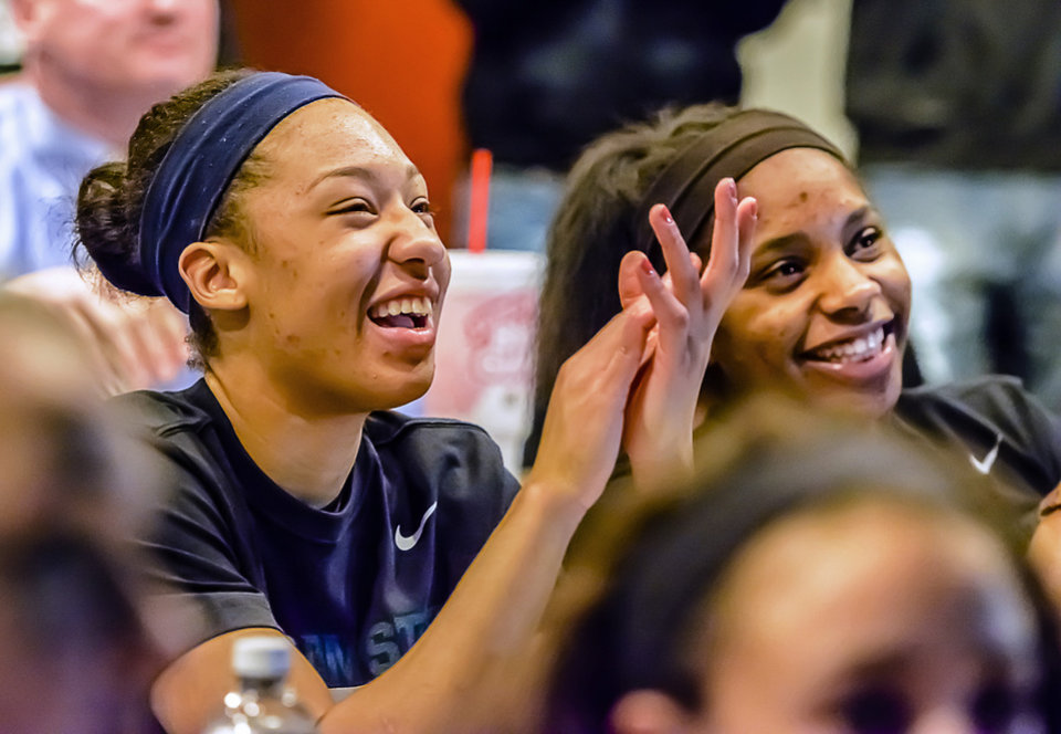 Photo - Aerial Powers, left, and Branndais Agee  of Michigan State University applaud at the Breslin Center in East Lansing, Mich., MOnday March 17, 2014, as they watch the broadcast of the NCAA basketall tournament selections.   (AP Photo/The State Journal, Kevin W. Fowler)  NO SALES