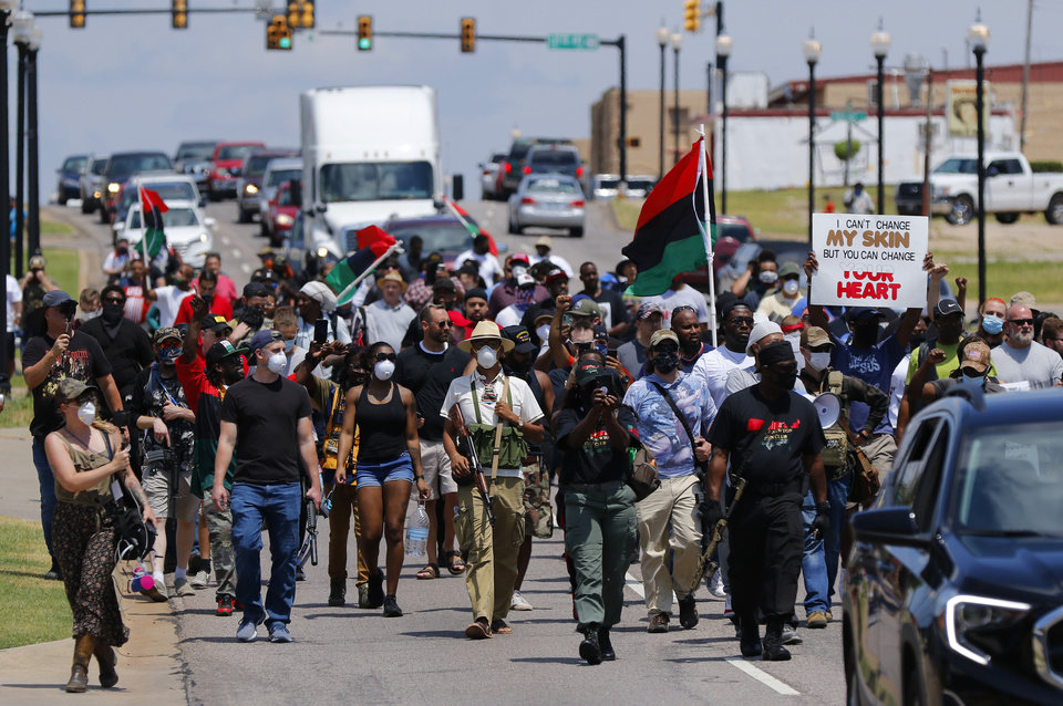 Photo - The marchers proceed west along NE 23rd to the Governor's Mansion at a 1,000 brothers and sisters in arms for second amendment walk by predominantly black men and women to advocate for their second amendment rights, Saturday, June 20, 2020. [Doug Hoke/The Oklahoman]