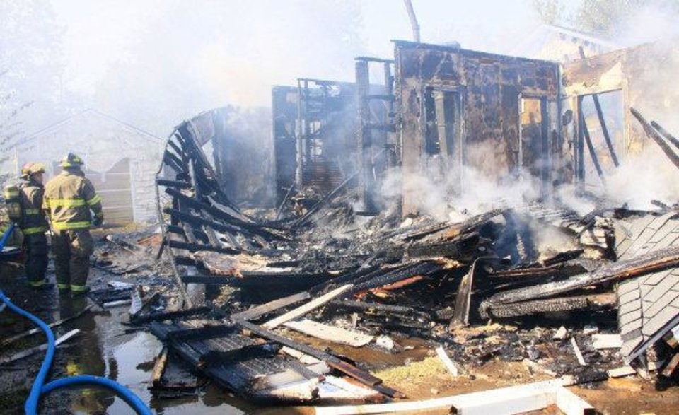 Photo - Home explosion in Ponca City. Robert Silvy, 84, was pulled from beneath the ruble of his home Wednesday afternoon by three passing motorists.  He was taken to a Ponca City hospital and later flown by helicopter to Via Christi Hospital in Wichita, Kan. Photo by Rolf Clements / The Ponca City News  ORG XMIT: KOD