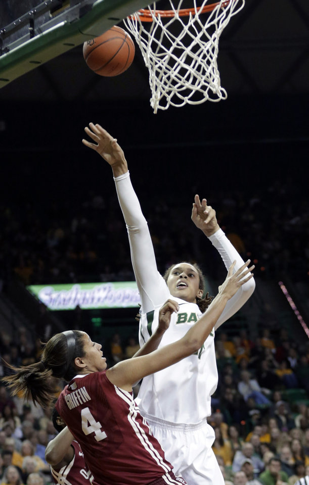 Baylor\'s Brittney Griner (42) shoots over Oklahoma\'s Nicole Griffin (4) during the second half of an NCAA basketball game Saturday, Jan. 26, 2013, in Waco Texas. Baylor won 82-65. (AP Photo/LM Otero) ORG XMIT: TXMO112