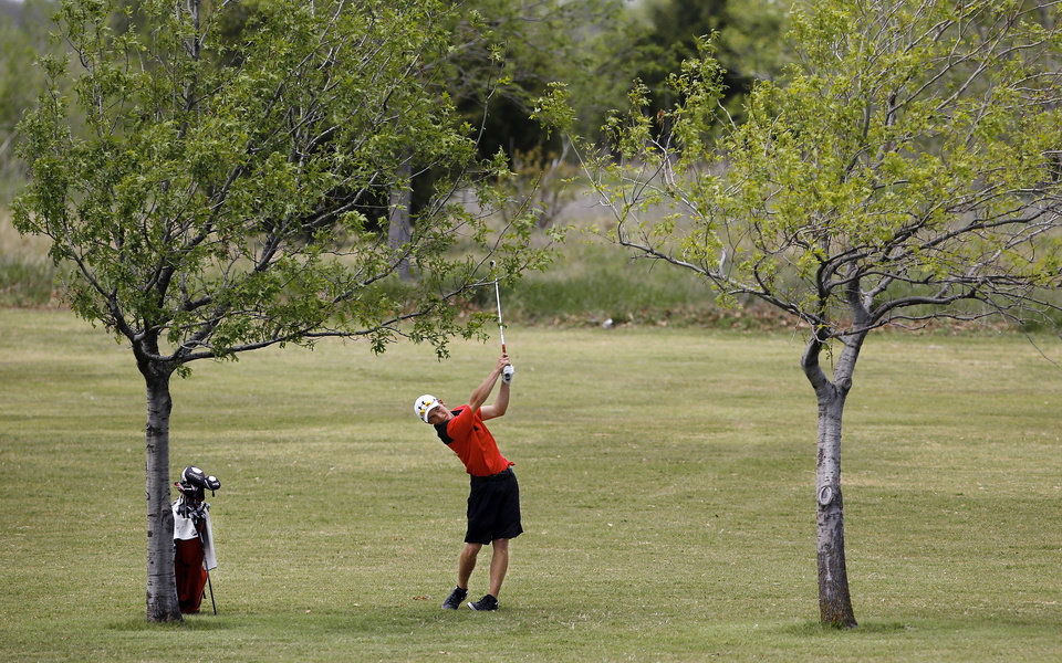 Photo - Cody Shore of Poteau hits a fairway shot on the 18th hole during Class 4A boy's state golf  tournament on Tuesday, May 7, 2013,  at  Hefner Golf Course in Oklahoma City.   Photo  by Jim Beckel, The Oklahoman.