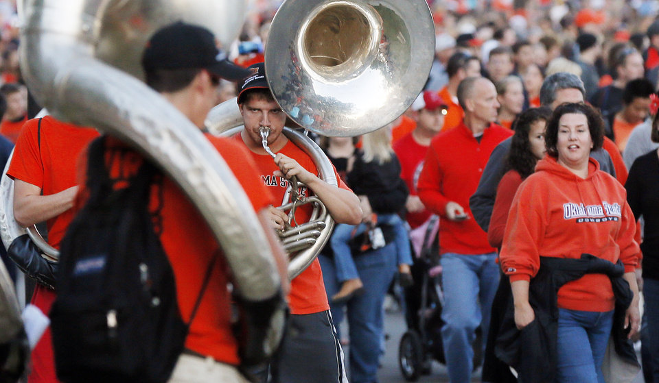 Sousaphone players from the OSU Cowboy Marching Band perform during Walkaround at Oklahoma State University's homecoming in Stillwater, Okla., Friday, Oct. 19, 2012. Photo by Nate Billings, The Oklahoman