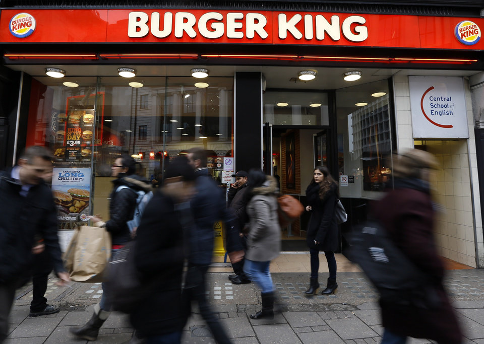 Photo - Pedestrians pass by a branch of Burger King in central London, Thursday, Jan. 24, 2013. Burger King says it has stopped buying beef from an Irish supplier whose patties in Britain and Ireland were found to contain traces of horsemeat. Officials say there is no risk to human health, but the episode has raised food security concerns. (AP Photo/Kirsty Wigglesworth)