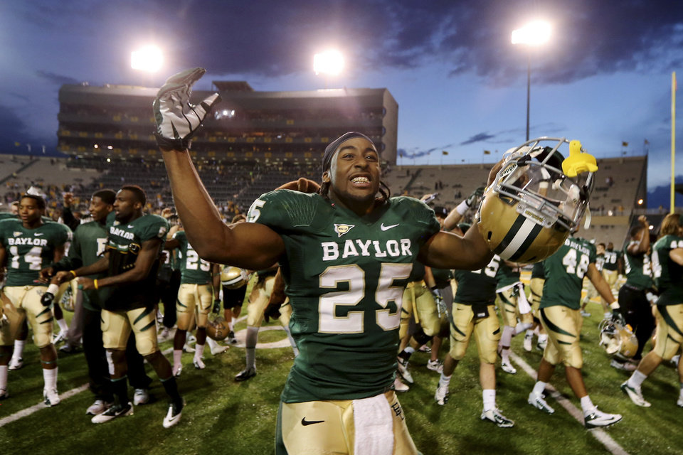 Photo - Baylor running back Lache Seastrunk (25) celebrates their 41-14 win over Kansas following an NCAA college football game on Saturday, Nov. 3, 2012, in Waco, Texas. (AP Photo/Waco Tribune Herald, Jerry Larson) ORG XMIT: TXWAC110