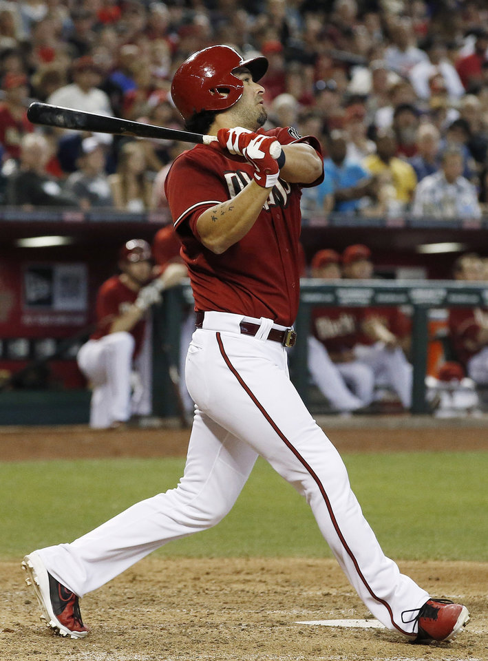 Photo - Arizona Diamondbacks' Eric Chavez connects on a 2-run home run against the Los Angeles Dodgers during the fifth inning of a baseball game on Sunday, May 18, 2014, in Phoenix. (AP Photo/Ross D. Franklin)