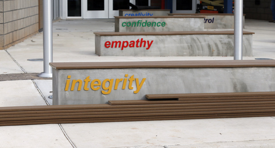 Photo - Values of Positive Tomorrows are on benches that also serve as barriers at the new facility for Positive Tomorrows, a school for homeless children, at 901 N Villa in Oklahoma City, Tuesday, Nov. 26, 2019. [Nate Billings/The Oklahoman]