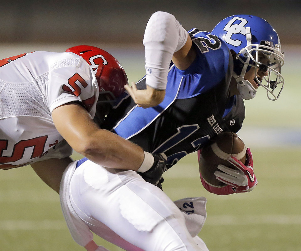 Carl Albert's Caleb Holland sacks Deer Creek's Joel Blumenthal during the high school football game between Deer Creek and Carl Albert at Deer Creek High School, Friday, Sept. 21, 2012.  Photo by Sarah Phipps, The Oklahoman