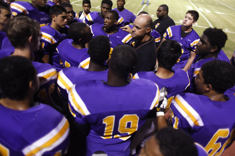 NWC Coach Smith talks with his team after the game at the Northwest Classen vs. Western Heights high school football game at Taft Stadium Thursday, September 20, 2012. Photo by Doug Hoke, The Oklahoman