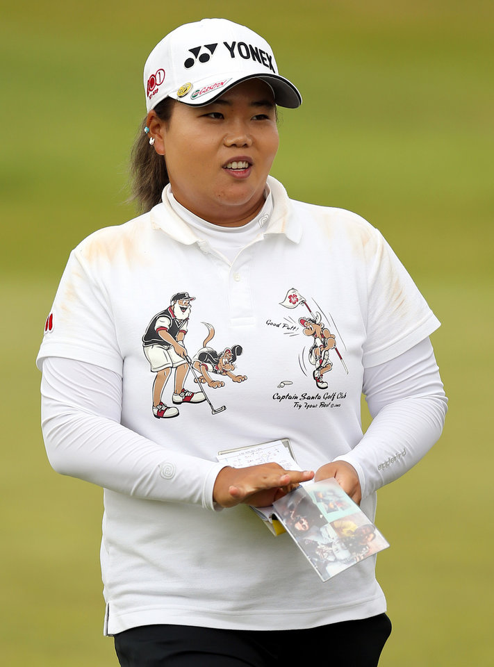 Photo - South Korea's Sun Ju Ahn finishes her round as the leader on the third day of the Women's British Open golf championship on the Royal Birkdale Golf Club, Southport, England, Saturday July 12, 2014. (AP Photo/Scott Heppell)