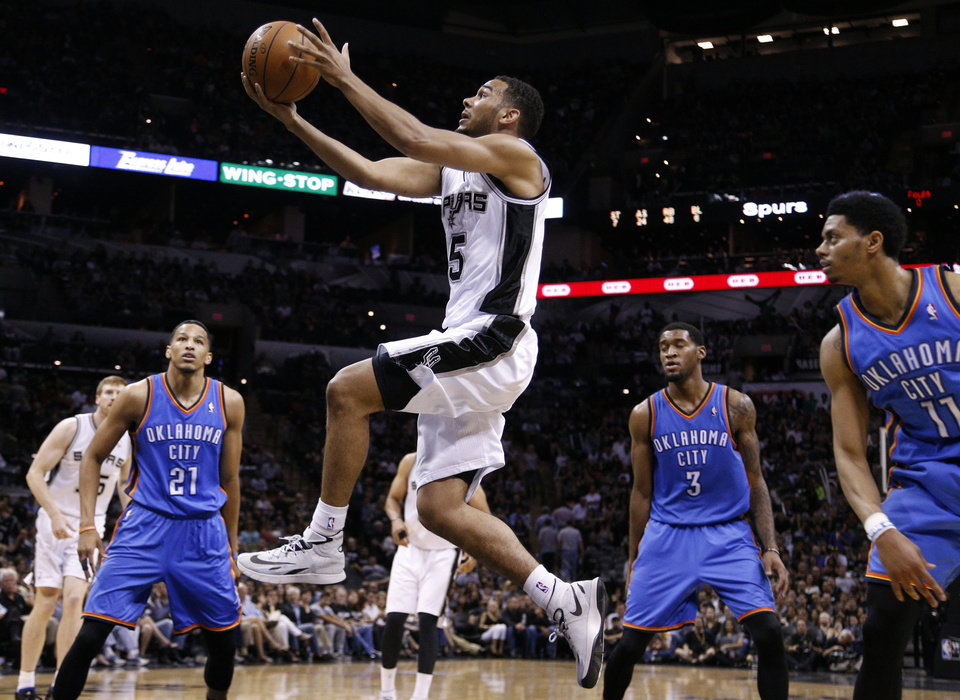 Photo - San Antonio's Cory Joseph (5) shoots a lay up in front Oklahoma City's Andre Roberson (21), Perry Jones (3) and Jeremy Lamb (11) during Game 2 of the Western Conference Finals in the NBA playoffs between the Oklahoma City Thunder and the San Antonio Spurs at the AT&T Center in San Antonio, Wednesday, May 21, 2014. Photo by Sarah Phipps