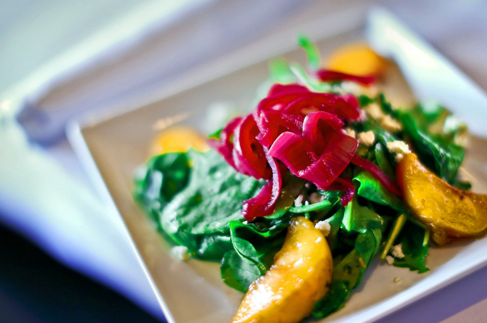 Seasonal Grilled Peach Salad prepared by chef Christine Dowd at The Metro Wine Bar and Bistro. <strong>CHRIS LANDSBERGER - THE OKLAHOMAN</strong>