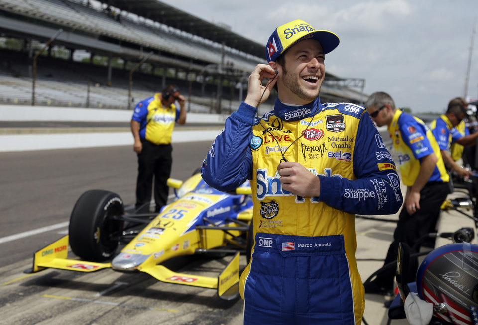 Photo - Marco Andretti laughs as he waits for the track to open during practice for the Indianapolis 500 IndyCar auto race at the Indianapolis Motor Speedway in Indianapolis, Monday, May 12, 2014. (AP Photo)