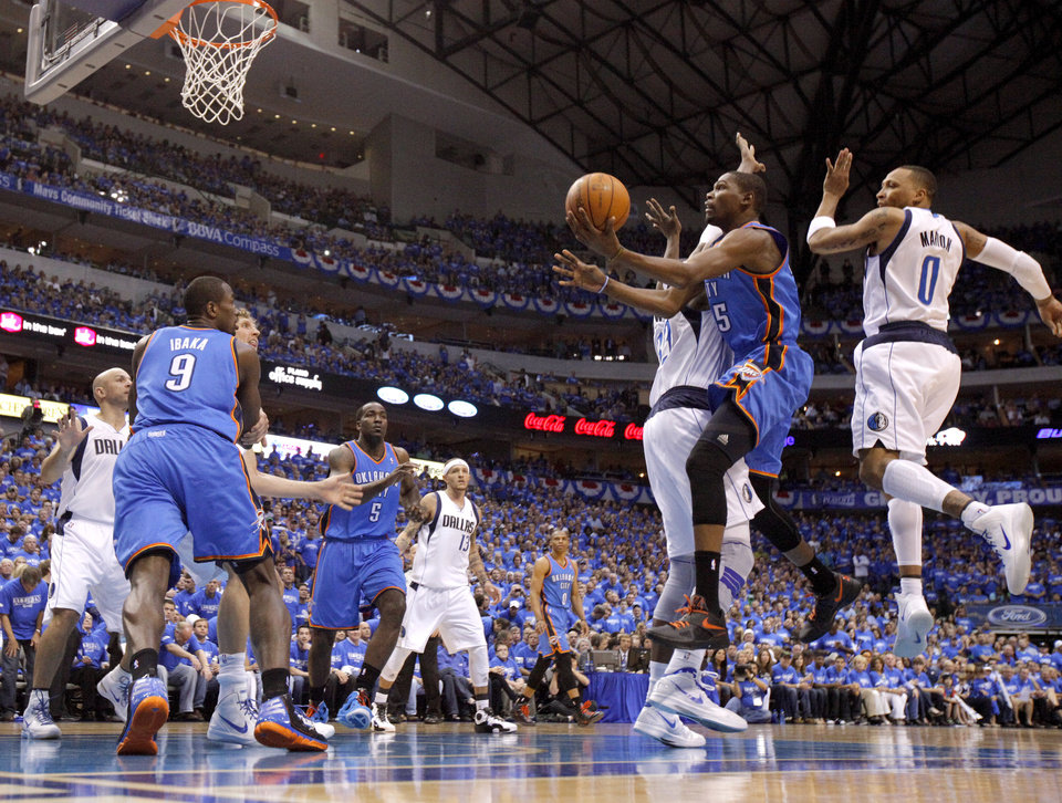 Photo - Oklahoma City's Kevin Durant (35) goes to the basket between Dallas' Brendan Haywood (33) and Shawn Marion (0) during Game 3 of the first round in the NBA playoffs between the Oklahoma City Thunder and the Dallas Mavericks at American Airlines Center in Dallas, Thursday, May 3, 2012. Photo by Bryan Terry, The Oklahoman