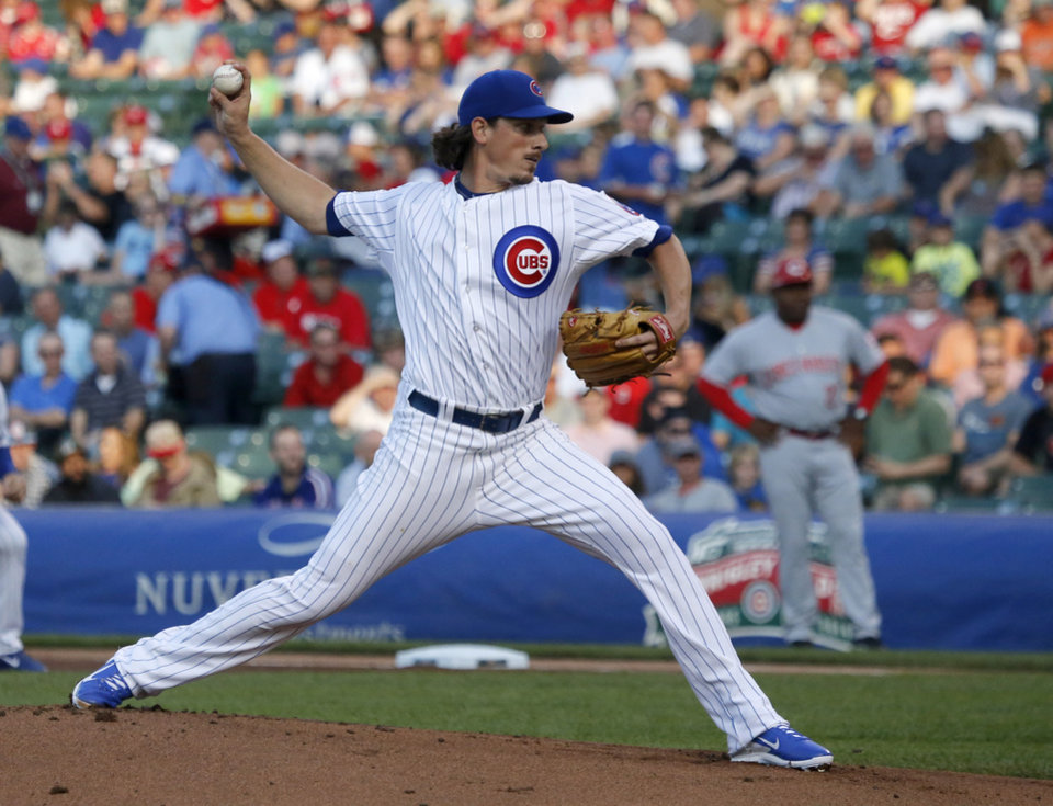 Photo - Chicago Cubs starting pitcher Jeff Samardzija delivers during the first inning of a baseball game against the Cincinnati Reds, Monday, June 23, 2014, in Chicago. (AP Photo/Charles Rex Arbogast)