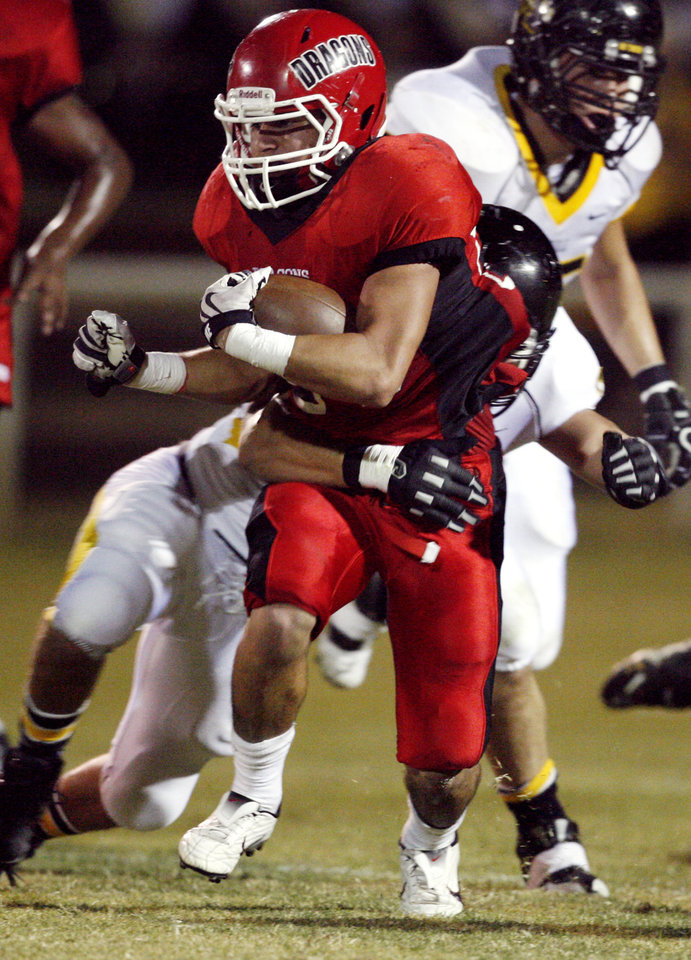 Photo - Madill's Zak Johnson (32) tries to tackle Purcell's Damian Dhea (28) in high school football as Madill plays at Purcell on Thursday, Oct. 1, 2010, in Purcell, Okla.  Photo by Steve Sisney, The Oklahoman