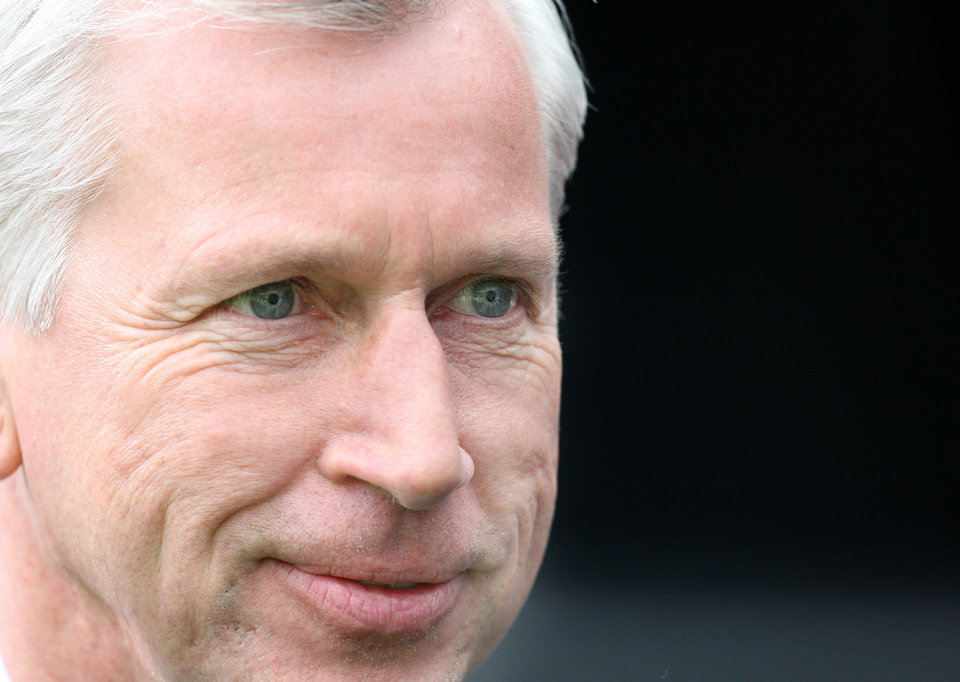 <p>Newcastle United's manager Alan Pardew, look's on ahead of their English Premier League soccer match against Manchester City at Newcastle United at the Sports Direct Arena, Newcastle, England, Sunday, May 6, 2012. (AP Photo/Scott Heppell)</p>