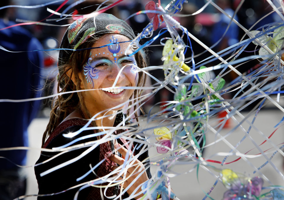 Above: Annie  Llamas, of Miami, Fla., stands by fairy wands Friday at the Medieval Fair in Norman.