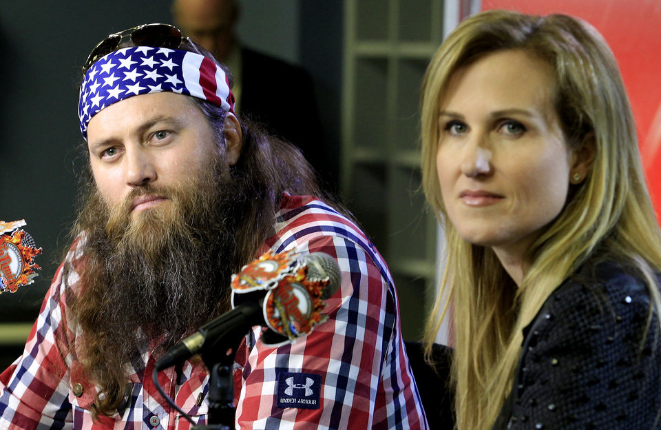 Photo - Duck Dynasty stars Willie and Korie Robertson at Texas Motor Speedway debuted their new Big Hoss TV, a 218 x 94 foot screen over the east grandstands of the racetrack, Wednesday, March 19, 2014. The first show to be seen on the screen by the public is Wednesday's episode of