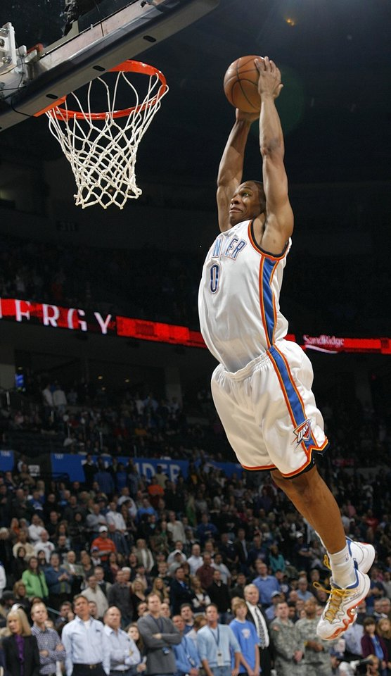 Photo - Russell Westbrook (0) of Oklahoma City dunks the ball during the NBA basketball game between the Oklahoma City Thunder and the New York Knicks at the Ford Center in Oklahoma City, January 11, 2010. Photo by Nate Billings, The Oklahoman ORG XMIT: KOD