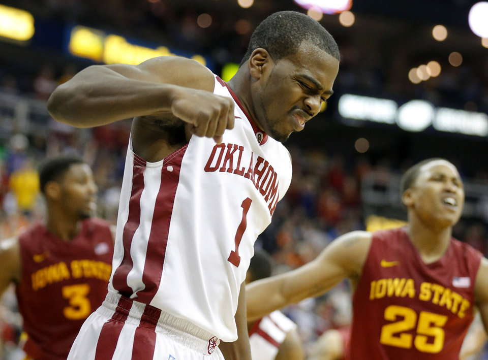 Photo - Oklahoma's Sam Grooms (1) reaches to a play during the Phillips 66 Big 12 Men's basketball championship tournament game between the University of Oklahoma and Iowa State at the Sprint Center in Kansas City, Thursday, March 14, 2013. Photo by Sarah Phipps, The Oklahoman