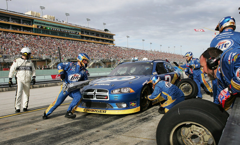 Brad Keselowski's pit crew services his car during the NASCAR Sprint Cup Series auto race at Homestead-Miami Speedway, Sunday, Nov. 18, 2012, in Homestead, Fla. (AP Photo/The Miami Herald, Andrew Uloza) MAGS OUT