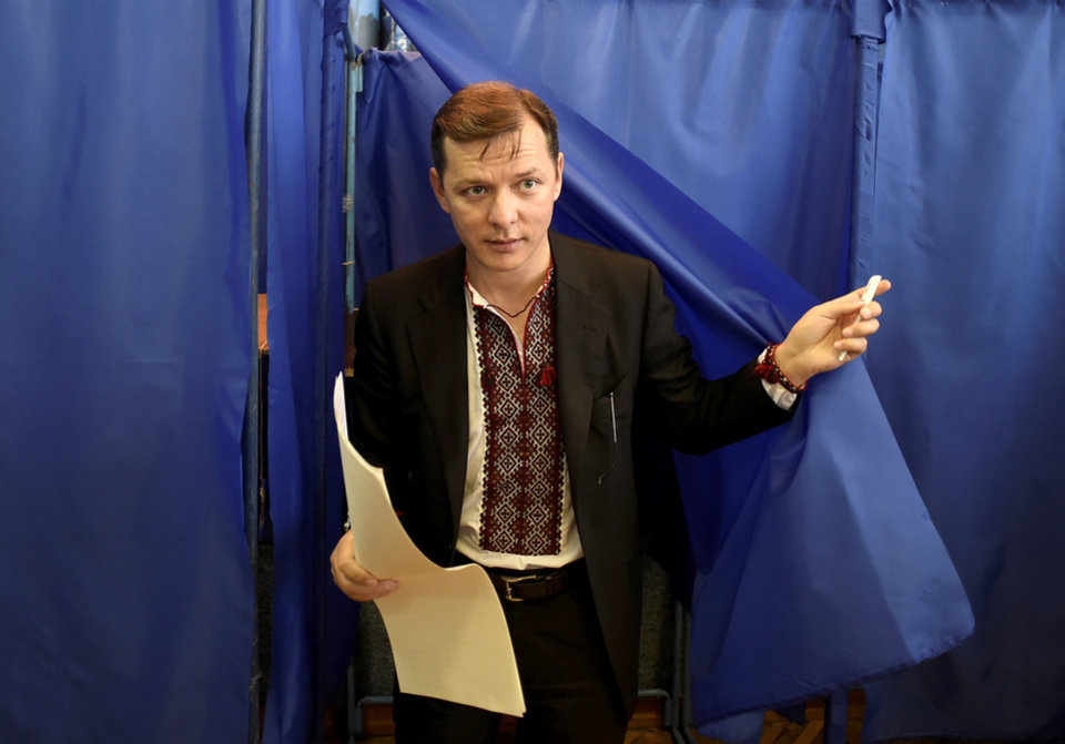 Photo - Ukraine's presidential candidate Oleh Lyashko leaves a booth  at a polling station during presidential election in Kiev, Ukraine, Sunday, May 25, 2014. Ukraine's critical presidential election got underway Sunday under the wary scrutiny of a world eager for stability in a country rocked by a deadly uprising in the east.(AP Photo/Osman Karimov)