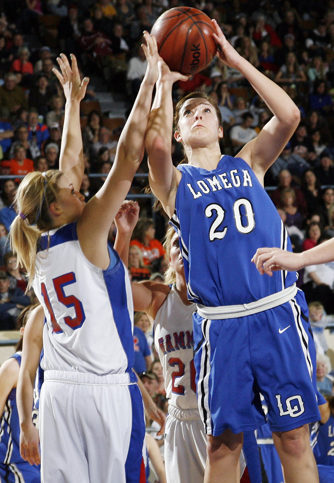 Photo - Lomega's Marta Stangl (20) shoots against Hammon's Kori Barrios (15) during the Class B girls state championship high school basketball game between Hammon and Lomega at State Fair Arena in Oklahoma City, Saturday, March 3, 2012. Lomega won, 49-44. Photo by Nate Billings, The Oklahoman
