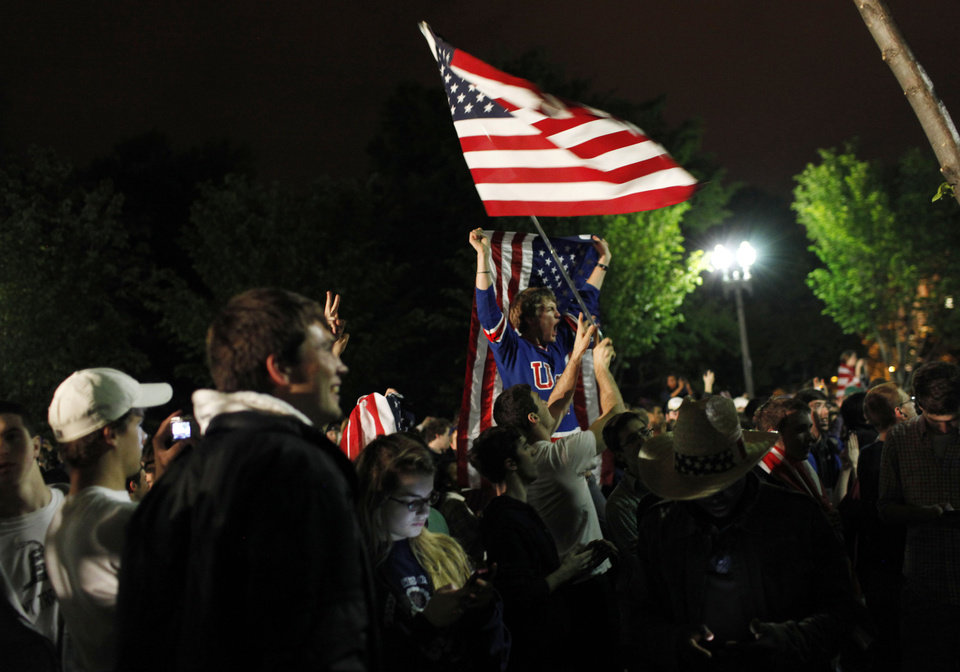Photo - Crowds gathers outside the White House in Washington to celebrate after President Barack Obama announced the death of Osama bin Laden Sunday, May 1, 2011. (AP Photo/Pablo Martinez Monsivais) ORG XMIT: DCPM101