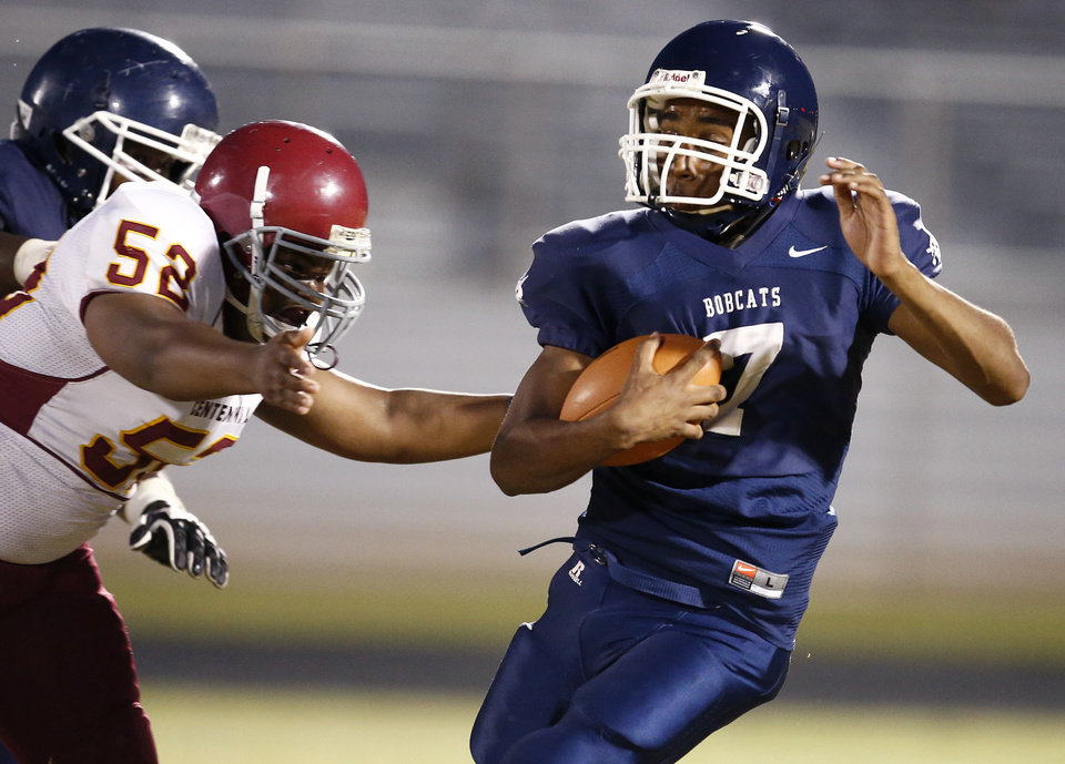 Photo - Star Spencer's Richard Maytubby runs past Centennial's Johnnie Johnson during the  All-City Preview football scrimmages at Douglass High School in Oklahoma City, Friday, August 29, 2014. Photo by Bryan Terry, The Oklahoman