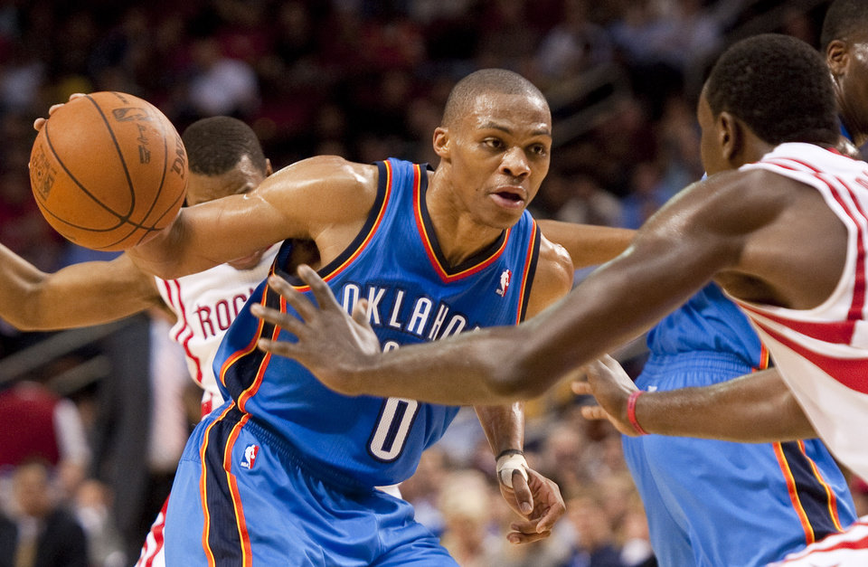 Oklahoma City Thunder's Russell Westbrook (0) drives against Houston Rockets' Samuel Dalembert, right, during the second quarter of an NBA basketball game, Wednesday, Feb. 15, 2012, in Houston. (AP Photo/Dave Einsel)