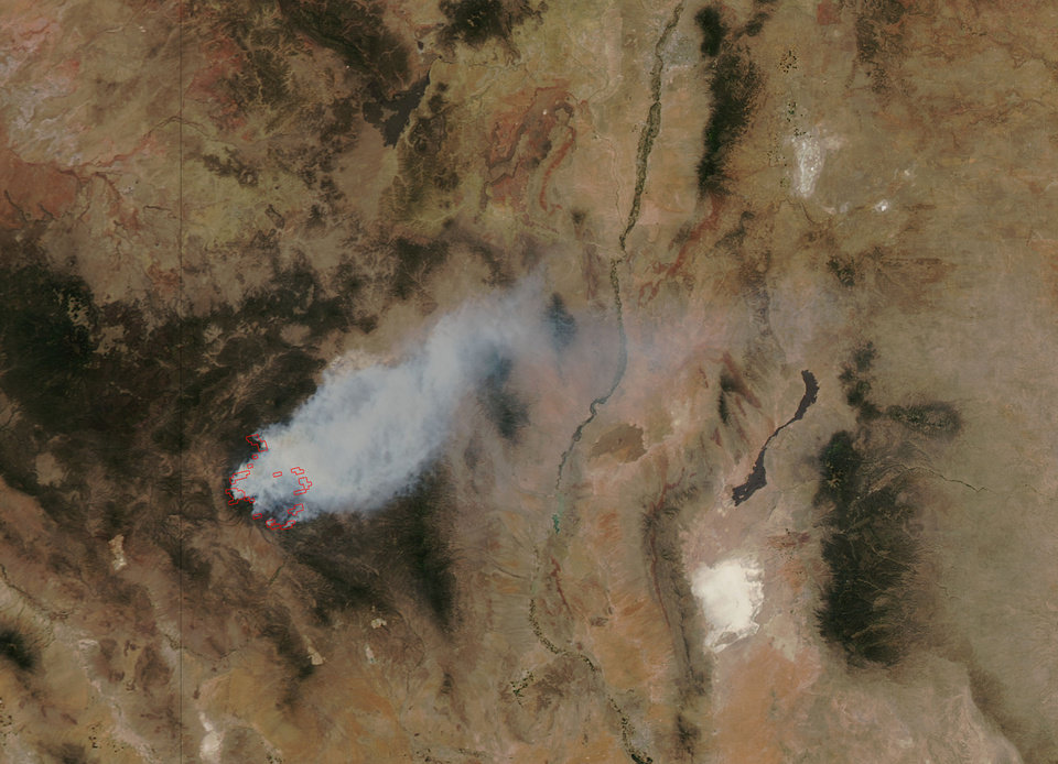 Photo -   This image provided by NASA shows the massive wildfire in New Mexico's Gila National Forest acquired by the Moderate Resolution Imaging Spectroradiometer (MODIS) sensor on NASA's Aqua satellite Tuesday May 29, 2012. The wildfire, already the largest in state history, spread in all directions Thursday May 31, 2012 and experts say it's likely a preview of things to come as states across the West contend with a dangerous recipe of wind, low humidity and tinder-dry fuels. Lightning started the Whitewater-Baldy fire on May 16, and more than a thousand firefighters have battled the blaze since then. (AP Photo/NASA)
