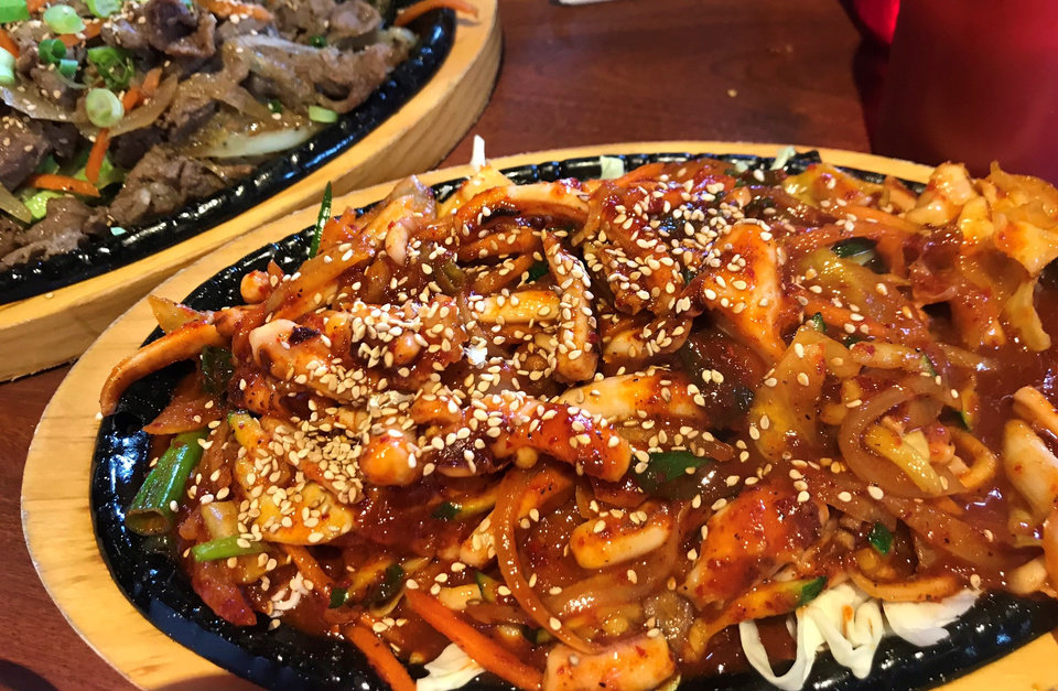 Photo - Bulgogi and ojingeo bokkeum from Taste of Korea in Oklahoma City. [Dave Cathey/The Oklahoman]