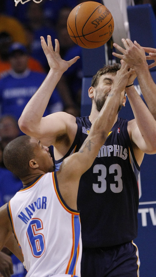 Photo - Oklahoma City's Eric Maynor (6) hits Marc Gasol (33) in the face as they battle under the basket during game one of the Western Conference semifinals between the Memphis Grizzlies and the Oklahoma City Thunder in the NBA basketball playoffs at Oklahoma City Arena in Oklahoma City, Sunday, May 1, 2011. Photo by Chris Landsberger, The Oklahoman