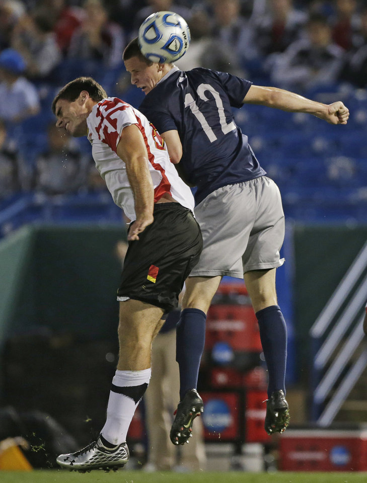 Georgetown\'s Keegan Rosenberry (12) fights Maryland\'s Jake Pace for the ball in the first half of a NCAA College Cup men\'s championship semifinal soccer match at Regions Park, Friday, Dec. 7, 2012, in Hoover, Ala. (AP Photo/Dave Martin)