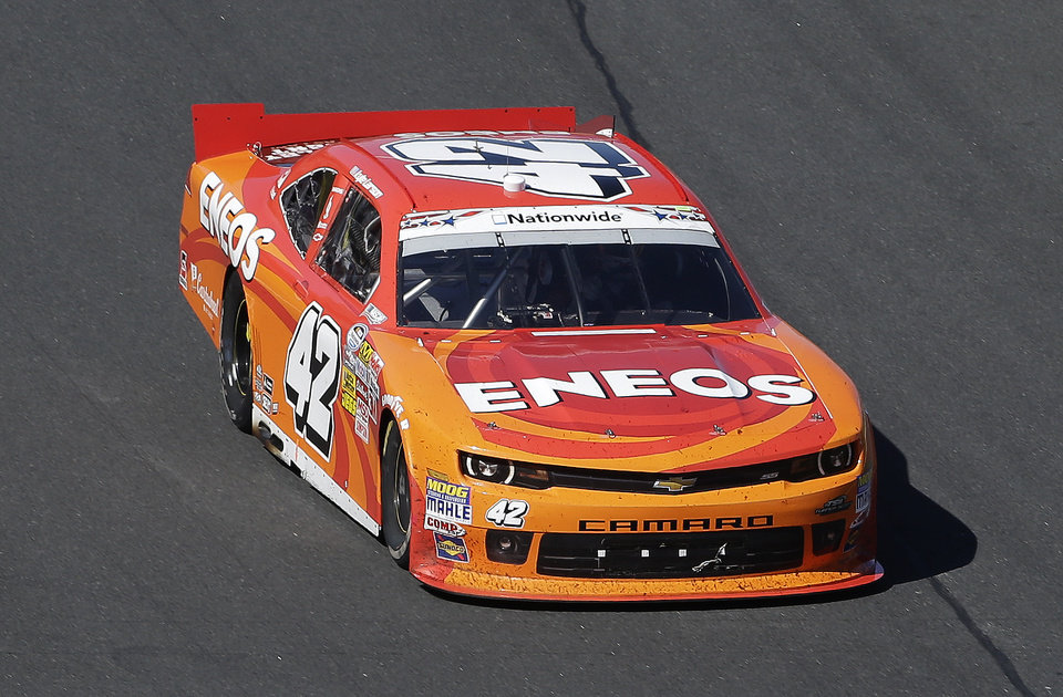 Photo - Kyle Larson (42) drives along the front stretch during the NASCAR Nationwide series History 300 auto race at the Charlotte Motor Speedway in Concord, N.C., Saturday, May 24, 2014. Larson won the race. (AP Photo/Gerry Broome)