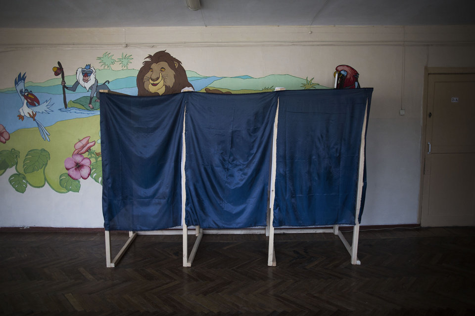 Photo - Voting booths for Sunday's referendum are seen at a polling station in Simferopol, Ukraine, Saturday, March 15, 2014. Tensions are high in the Black Sea peninsula of Crimea, where a referendum is to be held Sunday on whether to split off from Ukraine and seek annexation by Russia. (AP Photo/Manu Brabo)