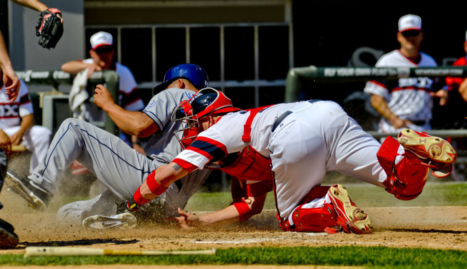 Photo - San Diego Padres' Will Venable scores off of a Alexi Amarista sacrifice fly ball as he slides past Chicago White Sox catcher Tyler Flowers during the sixth inning of a baseball game on Saturday, May 31, 2014, in Chicago. (AP Photo/Matt Marton)