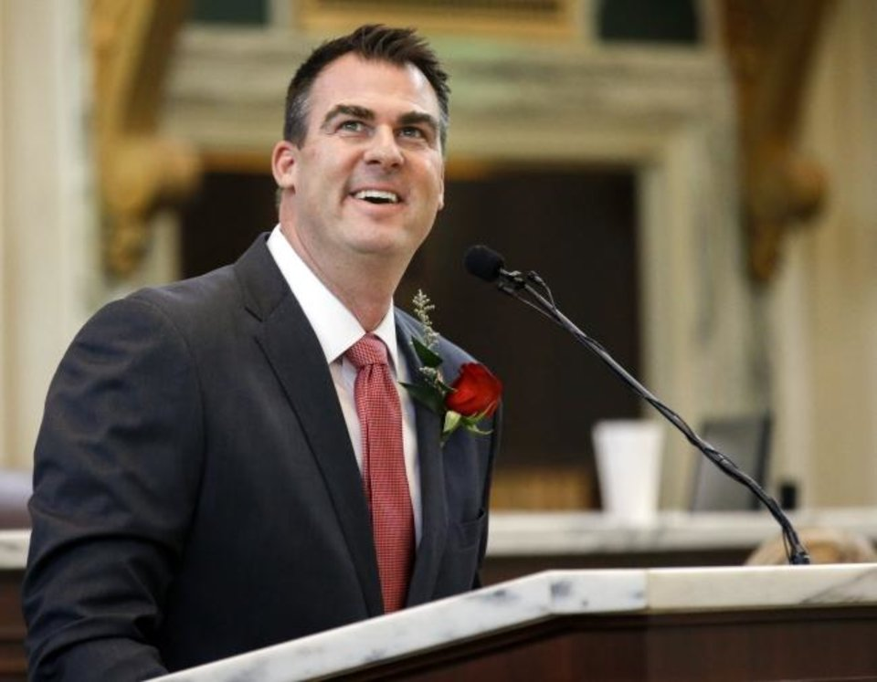Photo -  Gov. Kevin Stitt speaks in the House of Representatives chamber during Rose Day, an annual anti-abortion event, Wednesday at the state Capitol. [Nate Billings/The Oklahoman]