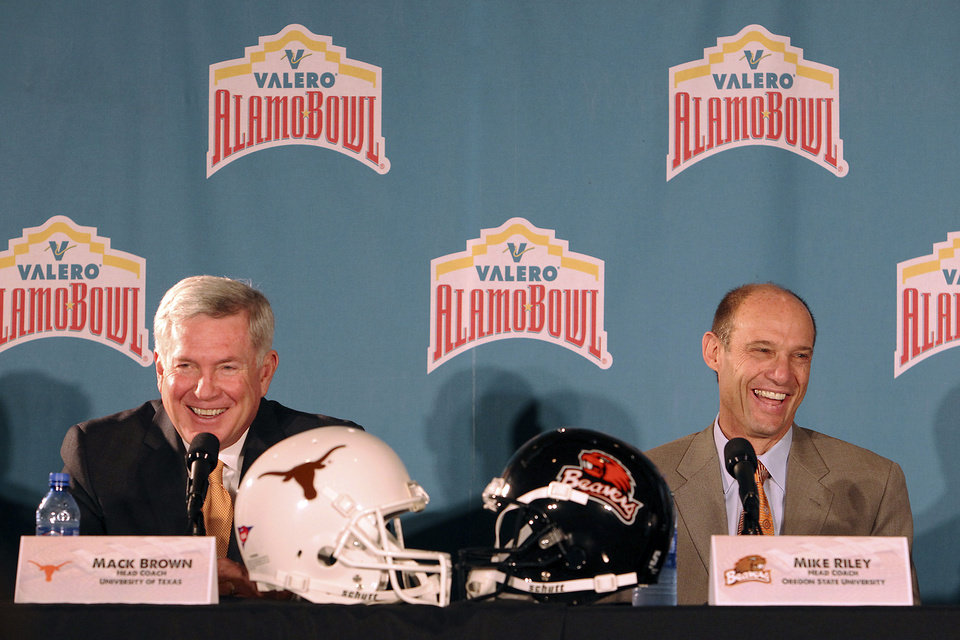 Texas coach Mack Brown, left, and Oregon State coach Mike Riley laugh during a news conference for the Alamo Bowl NCAA college football game at Sonterra Country Club on Thursday, Dec. 6, 2012, in San Antonio, Texas. The game will be played at the Alamodome on Saturday, Dec. 29. (AP Photo/San Antonio Express-News, Kin Man Hui) RUMBO DE SAN ANTONIO OUT; NO SALES