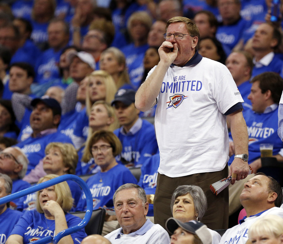 Photo - A fan boos the officials during Game 2 in the first round of the NBA playoffs between the Oklahoma City Thunder and the Memphis Grizzlies at Chesapeake Energy Arena in Oklahoma City, Monday, April 21, 2014. Memphis won 111-105 in overtime. Photo by Nate Billings, The Oklahoman