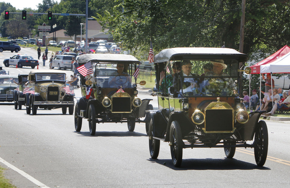 Photo - Vintage Ford automobiles pass by during Bethany's Fourth of July parade in Bethany, OK, Friday, July 4, 2014,  Photo by Paul Hellstern, The Oklahoman