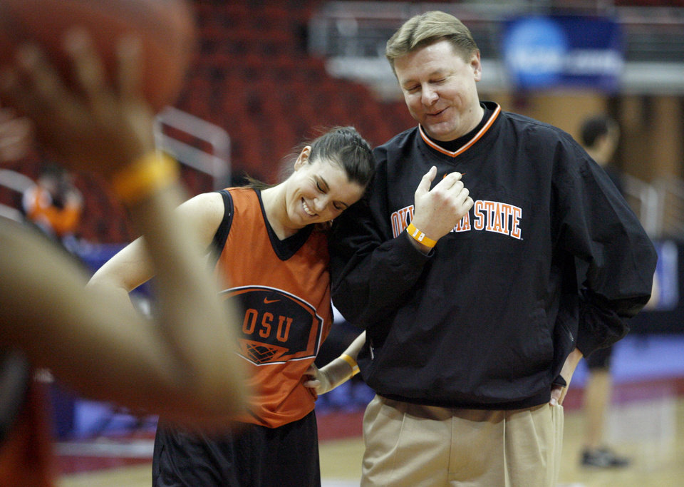 OSU\'s Taylor Hardeman and head coach Kurt Budke laugh during practice at Wells Fargo Arena in Des Moines, Iowa, Friday, March 21, 2008. Oklahoma State University will play East Tennesse State University in a first round game of the women\'s NCAA basketball tournament on Saturday. BY BRYAN TERRY, THE OKLAHOMAN