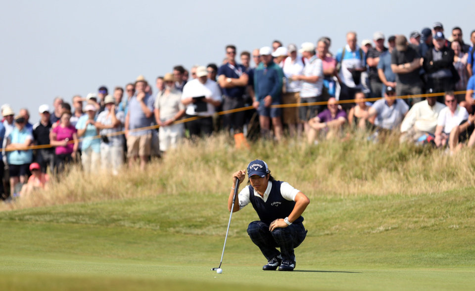 Photo - Ryo Ishikawa of Japan looks at his putt on the 6th green during the second day of the British Open Golf championship at the Royal Liverpool golf club, Hoylake, England, Friday July 18, 2014. (AP Photo/Peter Morrison)