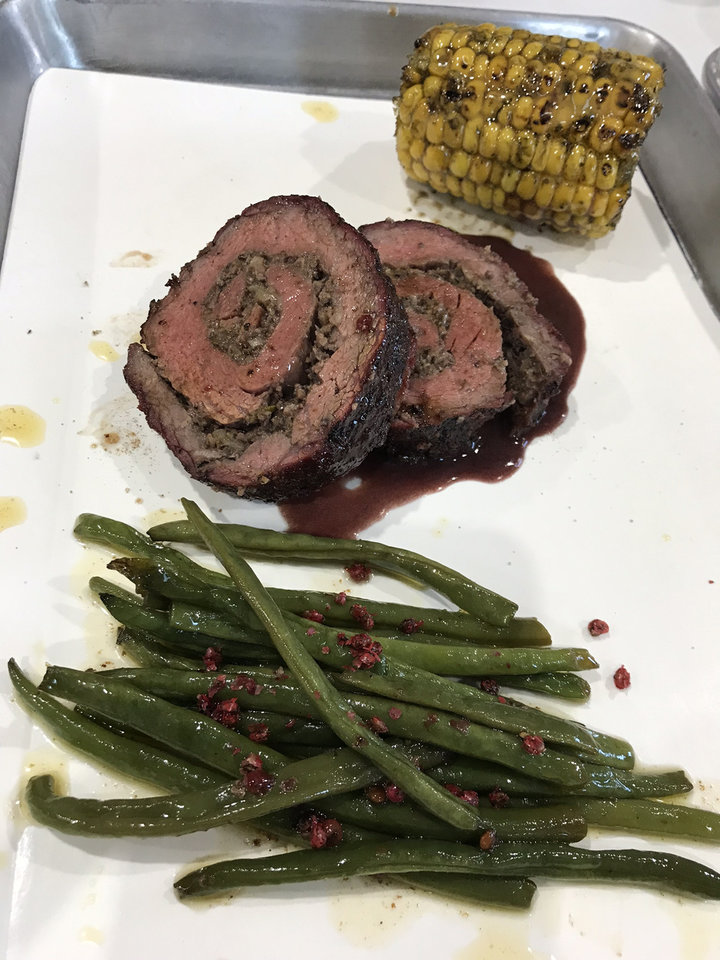 Photo - Smoked beef roulades with corn on the cob and green beans from Butcher BBQ Stand. [Dave Cathey/The Oklahoman]