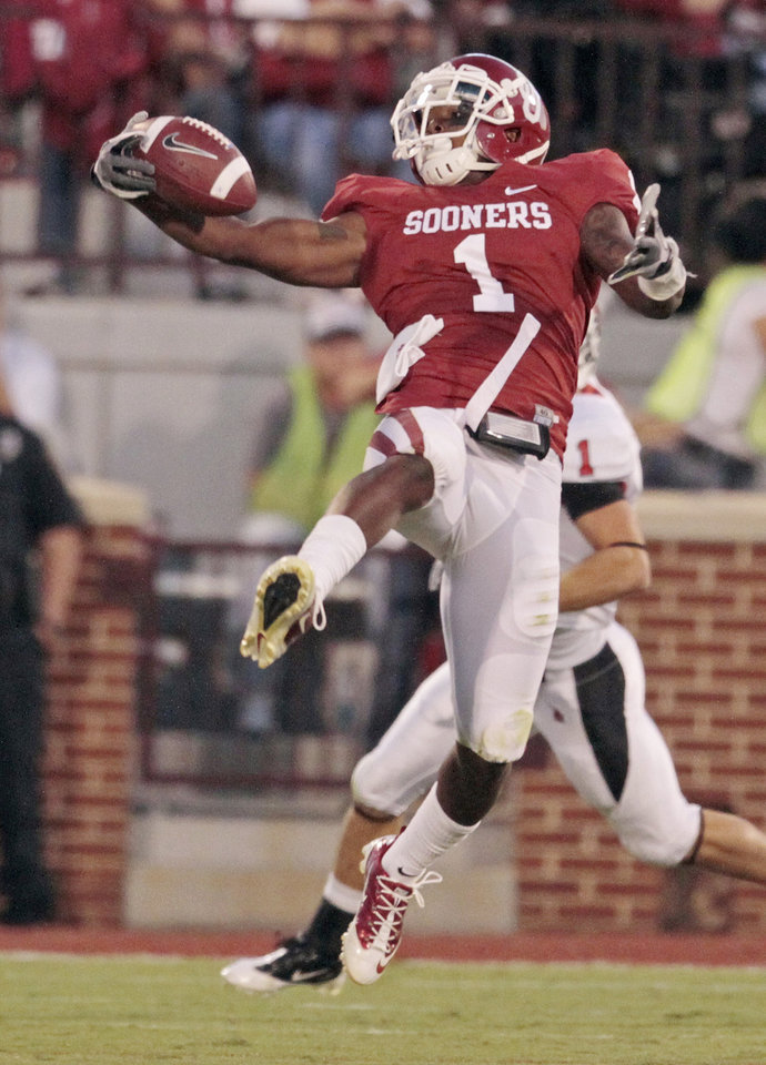 Oklahoma Sooners' Tony Jefferson (1) gets his second of three interceptions during of the second quarter the college football game between the University of Oklahoma Sooners (OU) and the Ball State Cardinals at Gaylord Family-Oklahoma Memorial Stadium on Saturday, Oct. 1, 2011, in Norman, Okla. Photo by Steve Sisney, The Oklahoman