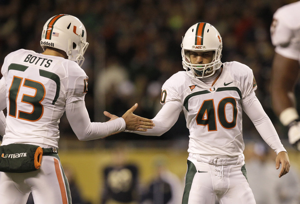Photo -   Miami kicker Jake Wieclaw (40) celebrates with holder Dalton Botts after Wieclaw's field goal during the first half of an NCAA college football game against Notre Dame at Soldier Field Saturday, Oct. 6, 2012, in Chicago. (AP Photo/Nam Y. Huh)