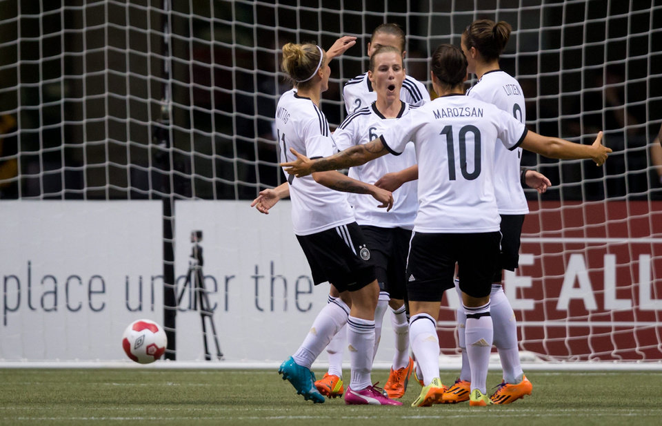 Photo - Germany's Anja Mittag, from left to right, Simone Laudehr, Dzsenifer Marozsan, Lena Lotzen and Bianca Schmidt, back, celebrate Laudehr's penalty kick goal against Canada during the second half of an international women's soccer game in Vancouver, British Columbia on Wednesday, June 18, 2014.  (AP Photo/The Canadian Press, Darryl Dyck)